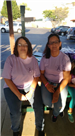 Women in Family Resource Center T-Shirts Seated at Picnic Table
